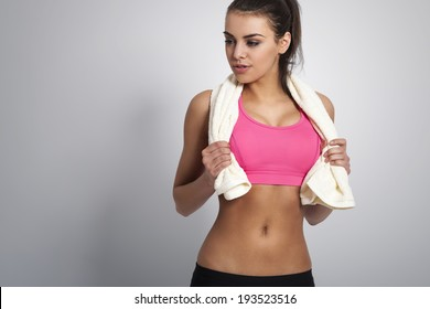 Sexy fit woman posing with towel