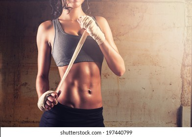 Sexy and fit woman preparing for training