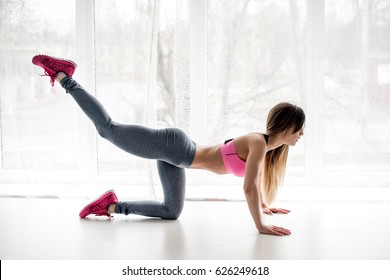 Sexy fitness model posing in studio. Exercises for fitness.