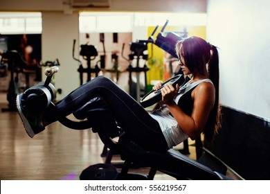 sexy fitness woman abs work out in gym. Long hair sporty woman.