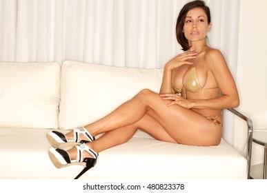 Sexy fitness woman in gold bikini