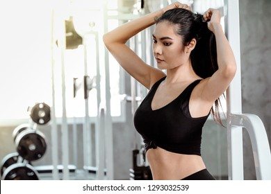 Sexy fitness women in sport wear with perfect body in the gym
