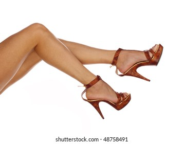 Sexy and funny legs in shoes on a white background