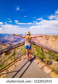 Sexy girl admires panorama of Grand Canyon National Park Desert View Point, northwestern Arizona: View of Steep-sided canyon carved by Colorado River in Arizona UNESCO WHS in 1979