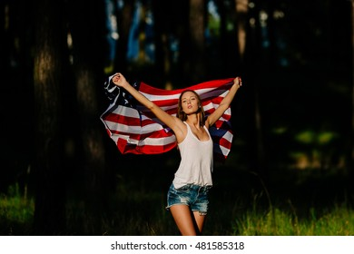 Sexy girl with American flag in hands.