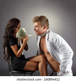 Sexy girl attracts dancer with pack of dollars