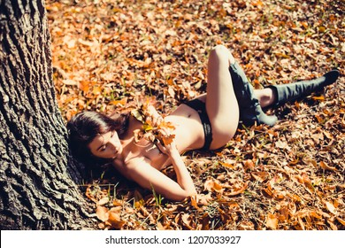 Sexy girl in autumn forest