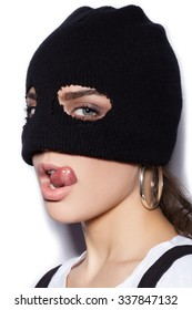 sexy girl in balaclava - crime and violence on white background not isolated