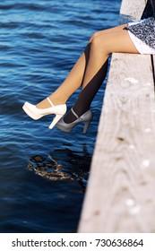 Sexy girl with beautiful legs near the sea