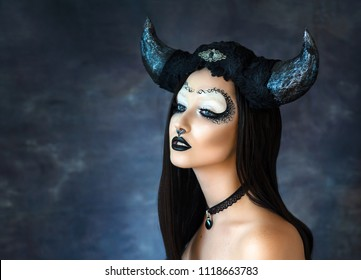 Sexy girl in black in the image signs of the Zodiac Taurus