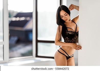sexy girl in black lingerie posing in bedroom