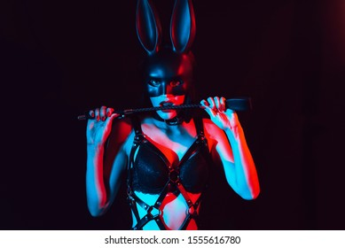 sexy girl dominatrix mistress in harness masked Bunny with leather Flogger for BDSM sex
