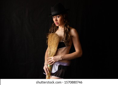 sexy girl in erotic costume is holding a broom. Positive cleaning