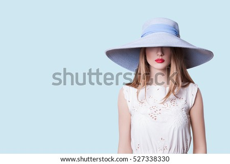 0b1c93fe41c Sexy Girl in Hat and Red Lips. Mysterious Beautiful Woman Looks out from  under the