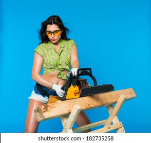 sexy girl holding a chainsaw