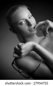 Sexy girl holding glasses, grayscale