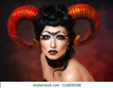 Sexy girl with horns in the shape of zodiac signs Aries