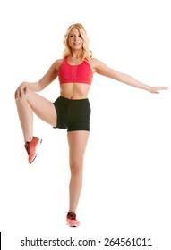 Sexy girl keeps balance while standing on one leg