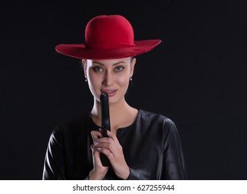 Sexy girl killer, brunette with a gun