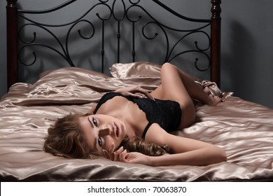 The sexy girl lies on a bed