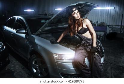 sexy girl in lingerie car repairs