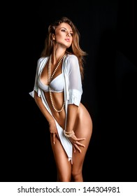 Sexy girl in lingerie on black background in studio