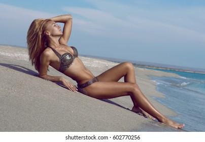 Sexy girl lying on the tripical beach