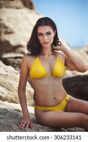 sexy girl with make up of the sea nude  naked body in yellow swimsuit unturned