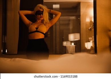 Sexy girl in a mask.Sexy blonde in the bedroom