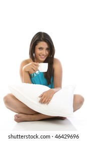 Sexy girl relaxing with cup of coffee