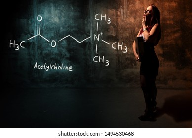 Sexy girl or secretary or female student presenting handdrawn chemical formula of acetylcholine education
