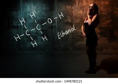 Sexy girl or secretary or female student presenting handdrawn chemical formula o ethanol molecule
