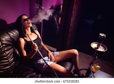 Sexy girl smokes hookah