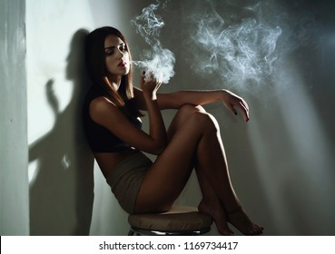 Sexy girl smoking cigarette