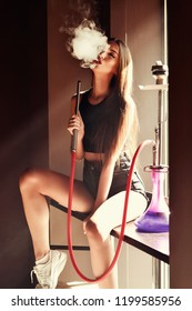 Sexy girl smoking hookah