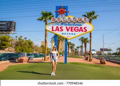 Sexy girl standing by the Welcome to Las Vegas sign in Nevada, USA. August 30, 2017