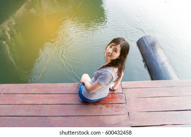 Sexy girl in stylish with perfect skin on raft