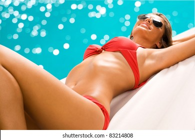 Sexy girl sunbathing on the beach