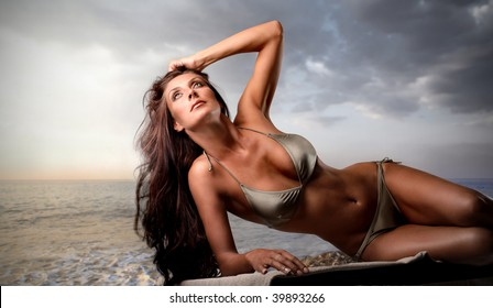 sexy girl tanning on the beach
