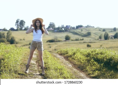 sexy girl in a t-shirt in a field / summer look, a beautiful young adult sexy model