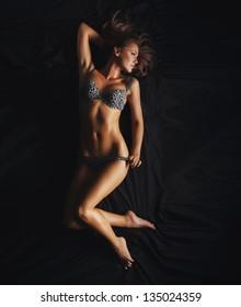 sexy girl in underwear on the silk bed