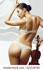 sexy girl in underwear of white color, perfect figure