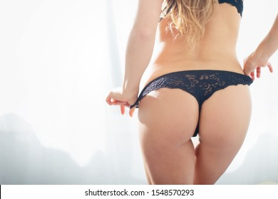 Sexy girl undresses in a sunny room