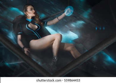 sexy girl in uniform on spaceship board flying in space. fantastic picture of young sexy girl on spaceship board in space.