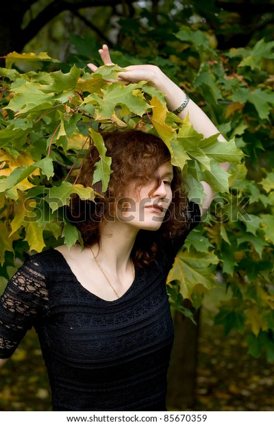 Sexy girl walking in autumn park