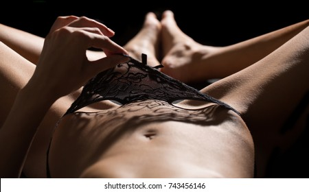 Sexy girl. Sexy woman. Woman masturbating and playing with herself in the bed. BDSM. Depilation concept. Waxing for woman. Laser hair removal bikini line and sexy body shapes.