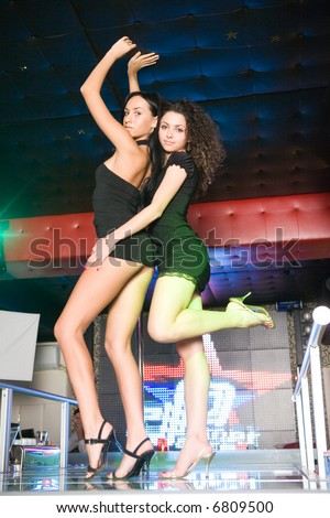 Sexy girls dancing in the club