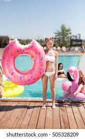 Sexy girls on summer party in the pool. 20s