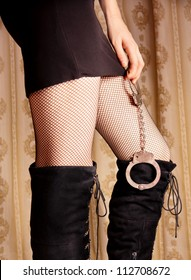 Sexy girls in stockings holds handcuffs