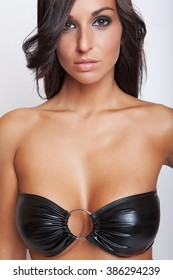 sexy glamour brunette girl in black bra with big breasts